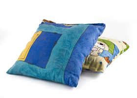 Two colorful pillows over white